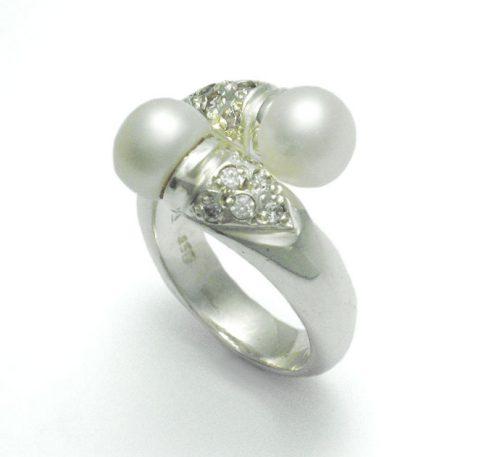 Anillo de plata ley 0,950 con peso 4 gramos con 2 perlas naturales de cultivo
