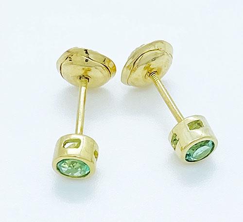 aretes de oro con esmeraldas de Colombia